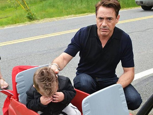 Robert Downey, Jr. attempting to console 18-month old Jaxson Denno