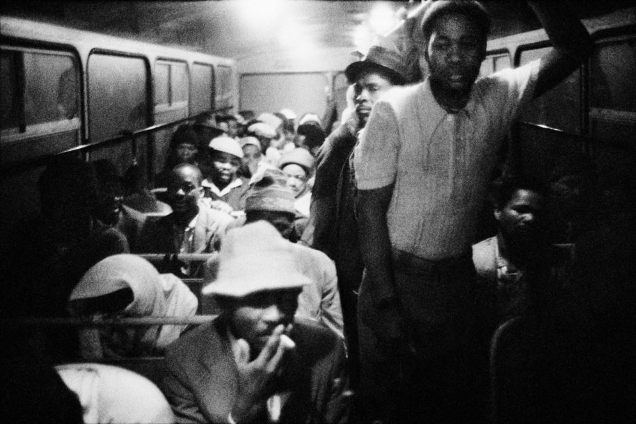 DAVID GOLDBLATT, 3:15 a.m. Going to work: The Wolwekraal - Marabastad bus is licensed to carry 62 sitting and 29 standing passengers, 1983, gelatin silver print image, 10 1/4 x 15 5/8 inches
