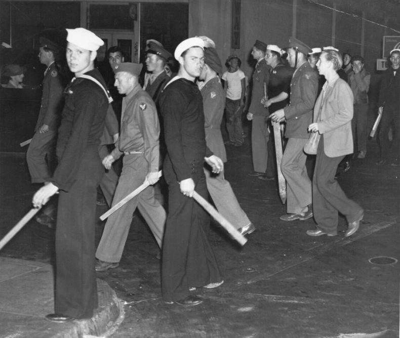 "U.S. armed forces personnel with wooden clubs on street during ""zoot suit"" riot, Los Angeles, Calif., 1943. Courtesy of Visual Materials from the National Association for the Advancement of Colored People Records/ Library of Congress."
