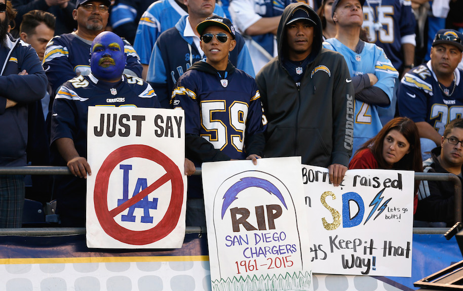 San Diego Chargers fans hold signs supporting the San Diego Chargers during a game against the Miami Dolphins at Qualcomm Stadium on December 20, 2015 in San Diego, California. (Photo by Sean M. Haffey/Getty Images)