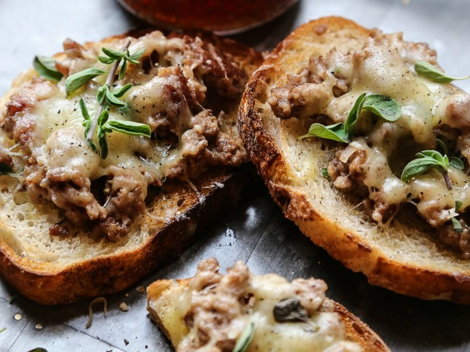 Sauteed Sausage and Four Cheeses Crostini