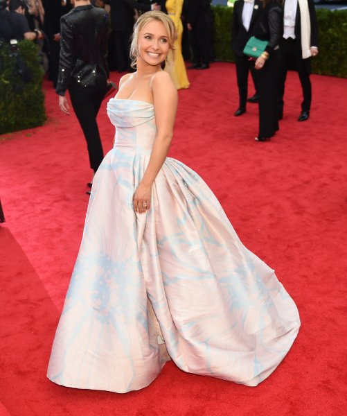 "Actress Hayden Panettiere slips on the stairs at the ""Charles James: Beyond Fashion"" Costume Institute Gala"