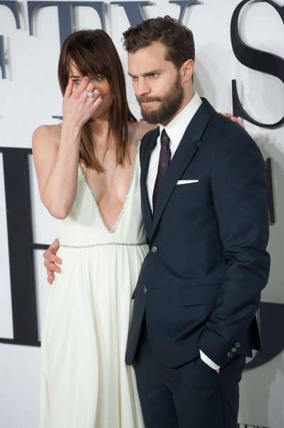Fifty Shades of Grey - UK film premiere held at the Odeon Leicester Square. Featuring: Dakota Johnson, Jamie Dornan Where: London, United Kingdom When: 12 Feb 2015 Credit: Daniel Deme/WENN.com