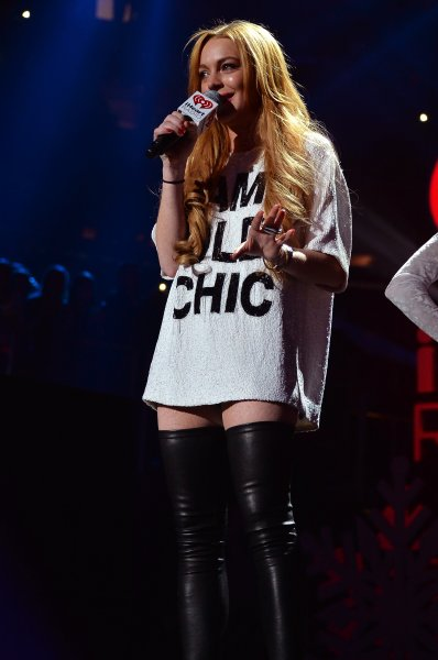 Lindsay Lohan speaks onstage during Z100's Jingle Ball 2013, presented by Aeropostale, at Madison Square Garden