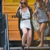 Lindsay Lohan seen on her cell phone leaving her Manhattan hotel