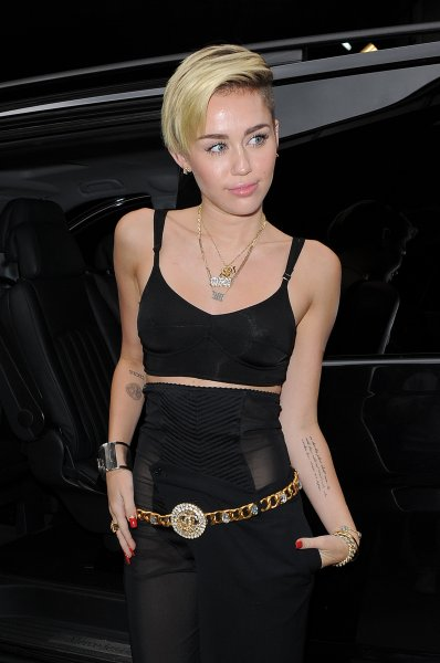Miley Cyrus arriving at an office building