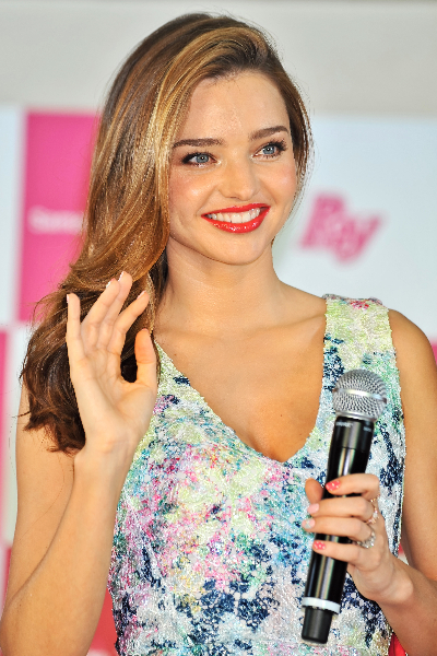 Miranda Kerr attends a photoshoot during the Samantha Thavasa Ladies Tournament at Eagle Point Golf Club