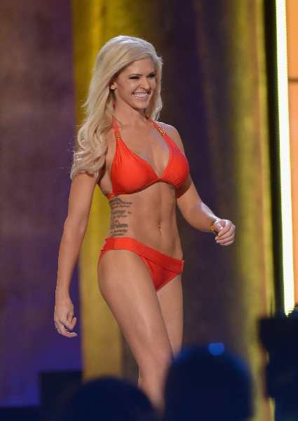 Miss America 2014 contestant Miss Kansas Theresa Vail performs in the bathing suit portion of the 2014 Miss America Competition