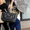 Singer Selena Gomez shields her face from getting photographs while leaving a tanning salon in Encino Ca