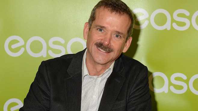 Astronaut Chris Hadfield signs copies of his book 'An Astronaut's Guide To Life'