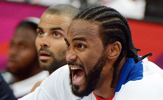 French centre Ronny Turiaf reacts during