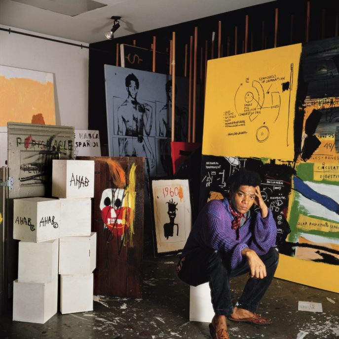 Jean Michel Basquiat in his Great Jones Street studio, New York, 1987. Tseng Kwong Chi (Chinese-Canadian-American, born Hong Kong, 1950–1990). Chromogenic print; 50 x 50 in. Muna Tseng Dance Projects, New York & Eric Firestone Gallery, East Hampton, New York. © 1987 Muna Tseng Dance Projects, Inc. New York. www.tsengkwongchi.com