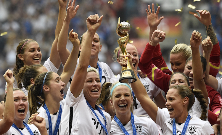 USA teammates hold the trophy following the teams' win in the final 2015 FIFA Women's World Cup match between USA and Japan at the BC Place Stadium in Vancouver on July 5, 2015. AFP PHOTO / FRANCK FIFE (Photo credit should read FRANCK FIFE/AFP/Getty Images)