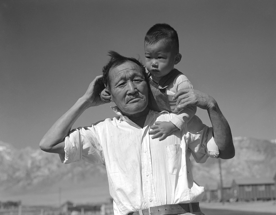 Japanese grandfather and grandson at Manzanar Relocation Center internment camp. Photo by Dorothea Lange