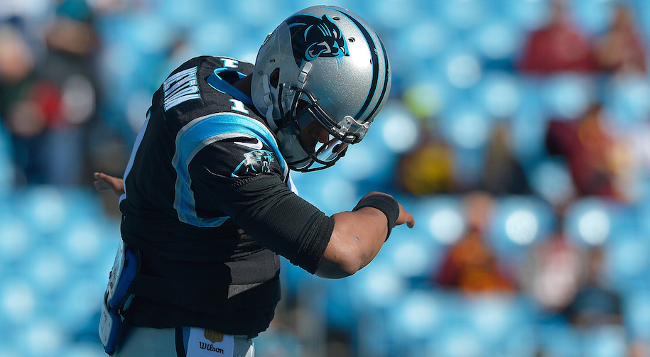 Cam Newton dabs or points to anyone in particular? Drink. (Photo by Grant Halverson/Getty Images)