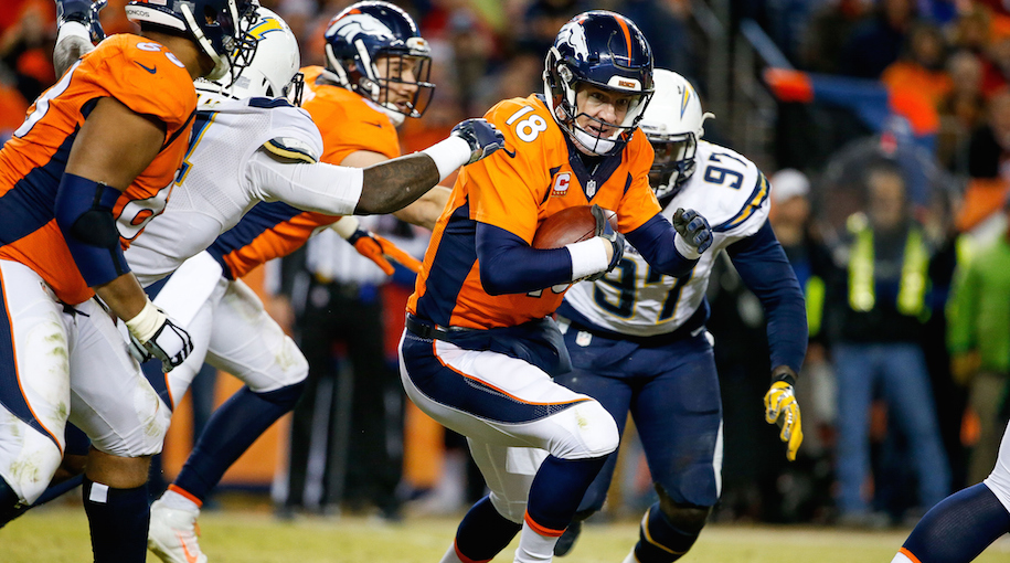 Is Peyton Manning running for his life? Drink. (Photo by Sean M. Haffey/Getty Images)