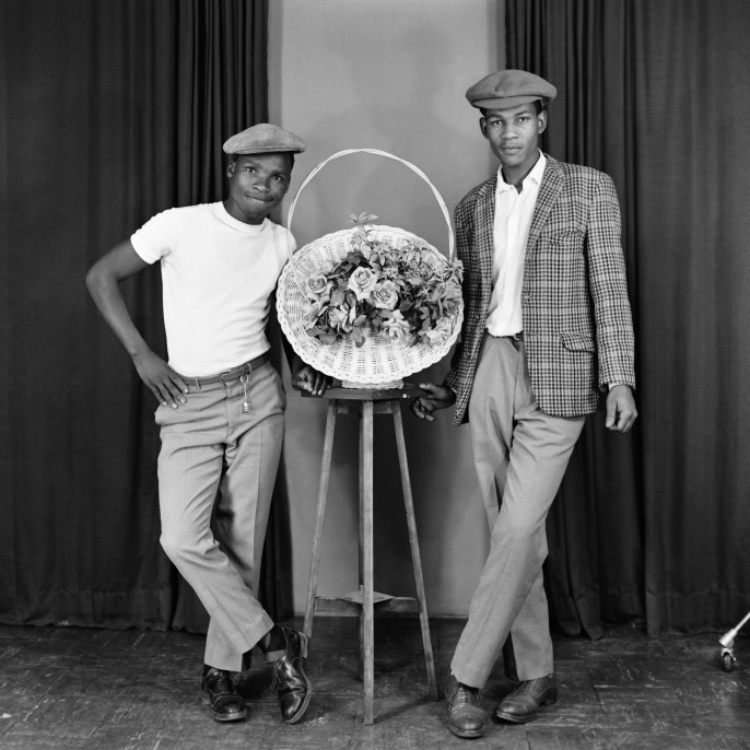 S. J. Moodley, [Two men with floral decoration], ca. 1978