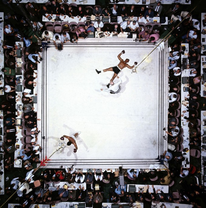 Neil Leifer (United States, b. 1942). Aerial view of Muhammad Ali victorious after round 3, knockout of Cleveland Williams during fight at Astrodome, November 14, 1966.