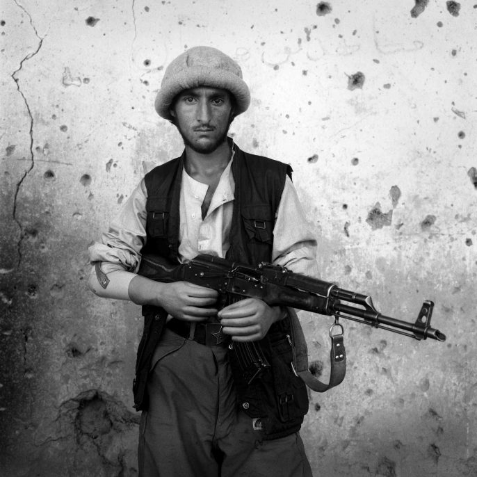 Bagram, 1998. An amputee soldier of the Northern Alliance poses for a photograph at the frontline near Bagram Airport. A former Russian base during the 1980s, Bagram is now the largest US military base inside Afghanistan.
