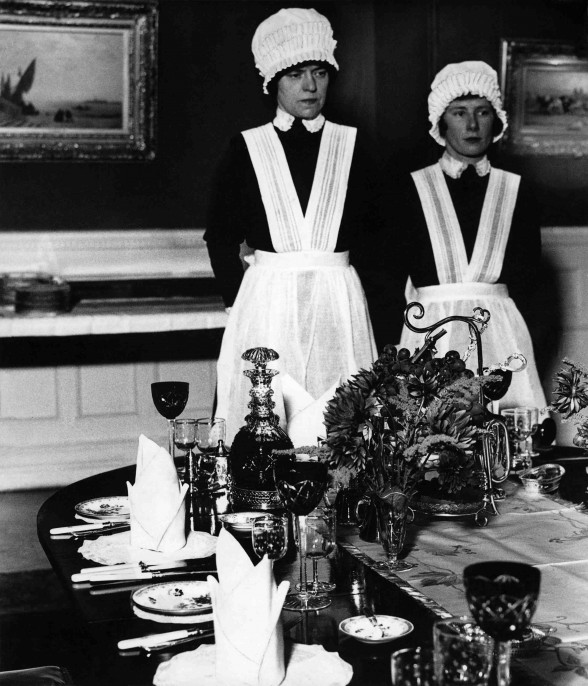 Parloumaid and under-parlourmaid ready to serve dinner, 1936 © Bill Brandt image courtesy of Beetles + Huxley