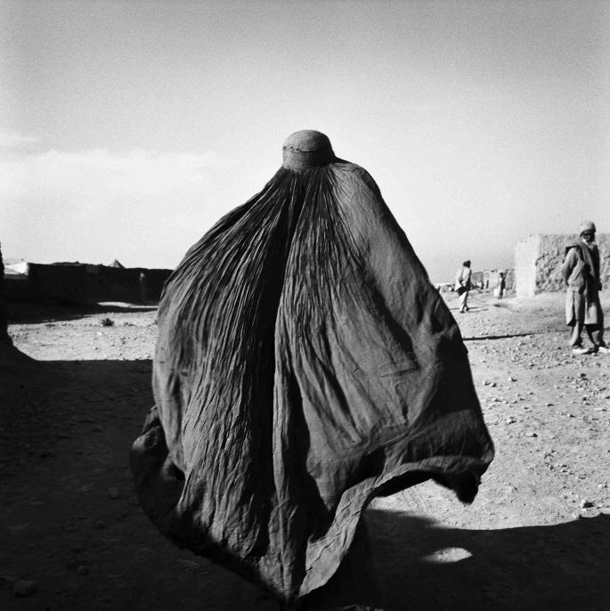 Pakistan, 2001. An Afghan woman refugee inside the Shamsoto Refugee Camp near Peshawar.