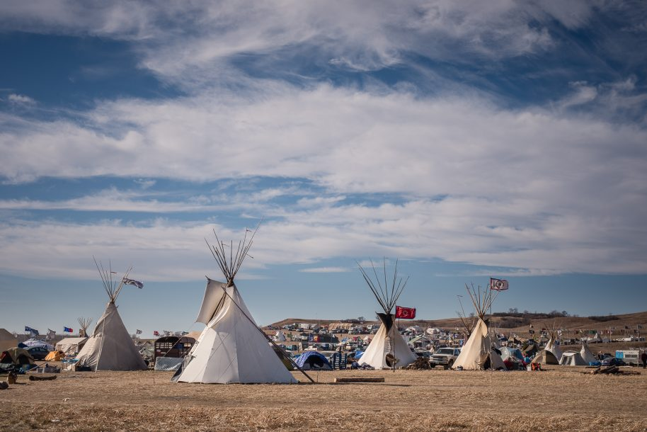 """A general view of Oceti Sakowin the Standing Rock encampment near Canon Ball, ND and on HWY 1806, which is currently blockaded by state police. There's a core group of protest organizers who reside at the camp permanently and various transient populations of Native and non-Native people from all over the country. The camp is very well organized with off grid """"amenities"""" from media support to cooking, mental health, medical, legal, and other services. Photo © Matt Hamon"""