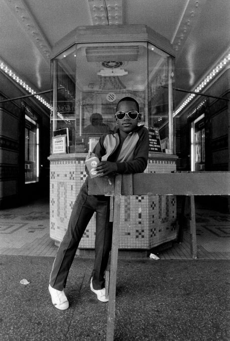 Dawoud Bey. A Boy in Front of the Loew's 125th Street Movie Theater 1976, Printed by 1979. Gelatin Silver print 230 x 150.