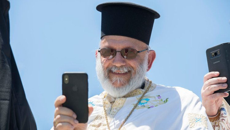 Greek priest with iPhone