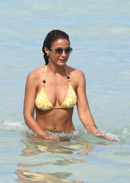 Emmanuelle Chriqui spends time on the beach with her boyfriend, Adrian Bellani Where: Miami Beach, Florida, United States When: 29 Aug 2013 Credit: KEYPIXX/WENN.com **Only available for publication in USA**