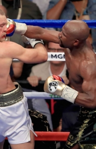 Mayweather gets a punch in